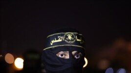 An Islamic Jihad militant marches during an anti-Israel military show in Gaza City September 27, 2012.