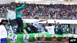 Supporters of incumbent Zambian President Edgar Lungu cheer on May 21, 2016, at the Heroes Stadium in Lusaka during the launch of his re-election campaign ahead of polling day on August 11.