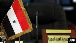 Пустующее место сирийской делегации на саммите ЛАГ в Багдаде.