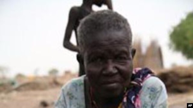 This woman, hands disfigured by leprosy and with no means of support, begs for food or any other offerings that can help her survive at a leper colony outside Juba, South Sudan's capital.