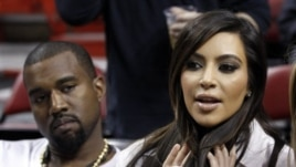 Kim Kardashian and Kanye West at an NBA basketball game last month