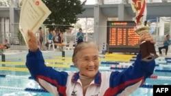Mieko Nagaoka celebrates her swimming record at a masters meet. (Japan Masters Swimming Association / AFP / Getty Images)