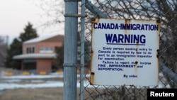 美國北部與加拿大接壤地帶明尼蘇達州處的告示。