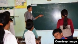 Oun Kosorl is seen teaching English to students at Mother Home Cambodia school. (Courtesy of Oun Kosorl)