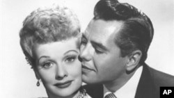 "Comedian-actress Lucille Ball and her husband, musician-actor Desi Arnaz from the comedy series, ""I Love Lucy"""