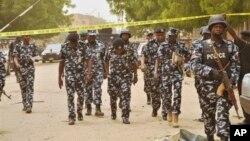 Policiers dans les rues de Kano au Nigeria le 19 mai 2014.