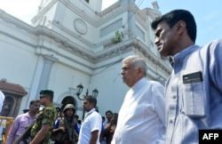 Sri Lankan Prime Minister Ranil Wickremasinghe (2nd R) arrives to visit the site of a bomb attack at St. Anthony's Shrine in Kochchikade in Colombo, April 21, 2019.
