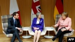 Emmanuel Macron, Theresa May, Angela Merkel