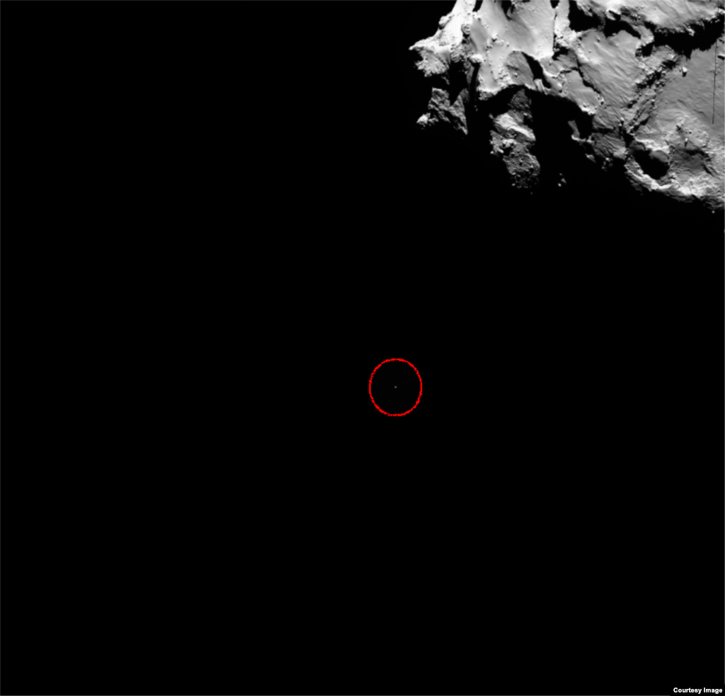 This OSIRIS wide-angle camera image shows the position of Rosetta's lander Philae (circled) on Nov. 12, 2014. (Courtesy: European Space Agency, photo released Nov. 13, 2014)