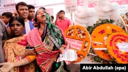 A relative of a victim of the Rana Plaza collapse cries during a memorial ceremony marking the third anniversary of the collapse of the eighty-story building in Dhaka, Bangladesh, 24 April 2016.