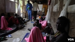 Wounded fighters from the Lou Nuer ethnic group, most of whom suffered gunshot wounds from recent fighting with Murle in Jonglei state, recover at a hospital in the state capital Bor where the atmosphere is more boastful and vengeful than sombre.
