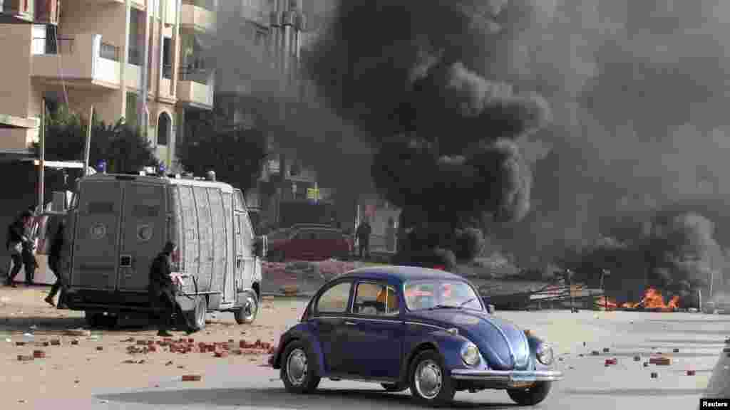 Smoke rises as Egyptian security forces clash with supporters of deposed Egyptian President Mohamed Morsi in Nasr City, Cairo, Jan. 8, 2014.