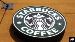 FILE- The Starbucks Coffee logo is seen in Mountain View, California, Jan. 3, 2012.