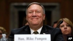 CIA Director Mike Pompeo, picked to be the next secretary of state, smiles after his introductions before the Senate Foreign Relations Committee during a confirmation hearing on his nomination to be Secretary of State, Thursday, April 12, 2018 on Capitol Hill in Washington.