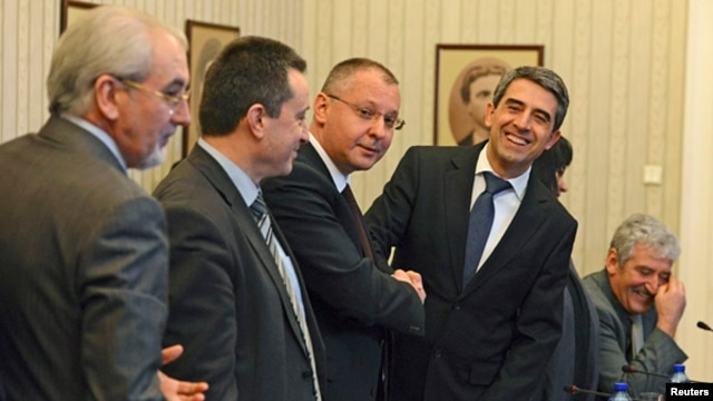 Bulgarian President Rosen Plevneliev (2nd R) before the start of his meeting with leaders of political parties in Sofia, February 22, 2013.