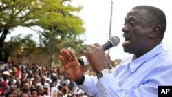 FILE - Uganda's main opposition leader and Inter Party flag bearer, Dr. Kiiza Besigye, addresses his supporters at Masaka Lyantonde, about 200 kms west of Kampala capital Uganda. Saturday, Nov. 6, 2010.
