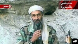 This image made from video broadcast on 07 Oct 2001 shows Osama bin Laden at an undisclosed location