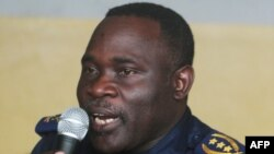 FILE - Former Kinshasa police chief, John Numbi, speaks while in court, Jan. 27, 2011.