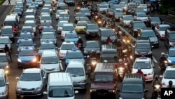 In this Sept. 24, 2010 photo, motorists are stuck in traffic jam during an evening rush hour at the main business district in Jakarta, Indonesia. (AP Photo/Tatan Syuflana)