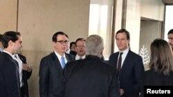 "White House senior adviser Jared Kushner and Treasury Secretary Steven Mnuchin arrive at Manama's Four Seasons hotel, the venue for the U.S.-hosted ""Peace to Prosperity"" conference, in Manama, Bahrain, June 25, 2019."