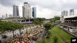 Protesters march on a street during a rally to demand for electoral reforms in Kuala Lumpur, Malaysia, April 28, 2012.