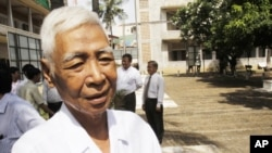In this photo taken on Aug. 9, 2010, a Cambodian survivors, Vann Nath, 66, is seen at Tuol Sleng genocide museum, formerly Khmer Rouge's notorious S-21 prison in Phnom Penh, Cambodia. Nath lapsed into a coma in late August, 2011, after developing breathin
