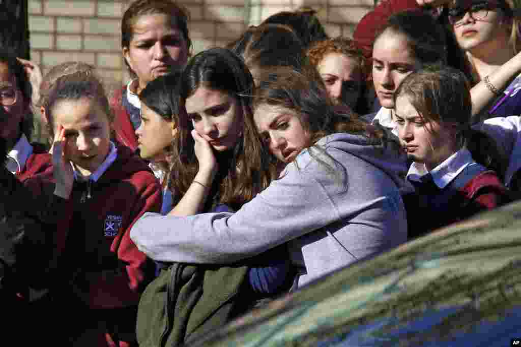 Students from the Yeshiva School in the Squirrel Hill neighborhood of Pittsburgh stand outside Beth Shalom Synagogue, after attending the funeral service for Joyce Fienberg. Fienberg, 75, Melvin Wax, 87, and Irving Younger, 69, were laid to rest as part of a weeklong series of services for the 11 people killed in a shooting Saturday at the Tree of Life synagogue.