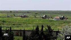 Боевые вертолеты сирийской армии на авиабазе Маннаг в провинции Алеппо. Сирия (архивное фото)