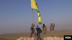 Kurdish Fighters Celebrate Kobani Victory