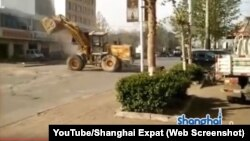 Bulldozers battle in the streets of China. This bulldozer fight received over 1.6 million views since it was posted on YouTube in mid-April.