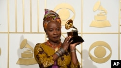 "FILE - Angelique Kidjo, seen in this Feb. 15, 2016 photo with award for best world music album for ""Sings"" at the 58th annual Grammy Awards, has won a human rights award, along with three African youth activist movements, for their work defending freedom of expression and peaceful protest."
