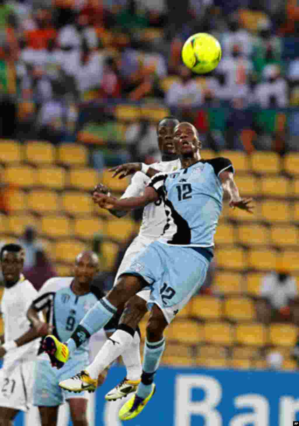 Botswana's Patrick Motsepe (front) challenges Anthony Annan of Ghana during their African Cup of Nations Group D soccer match in FranceVille Stadium.