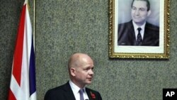 British Foreign Secretary William Hague, looks on during a presser under a poster showing Egyptian President Hosni Mubarak at the Foreign ministry in Cairo, Egypt (File Photo).