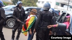 Zimbabwe police detain women protesting against woman trafficking.