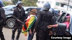 Zimbabwe police detain women protesting against woman trafficking.