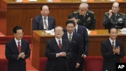 China's President Hu Jintao (L), former President Jiang Zemin (C) and Premier Wen Jiabao (R) attend the commemoration of the 100th anniversary of the Xinhai Revolution at the Great Hall of the People in Beijing, October 9, 2011.