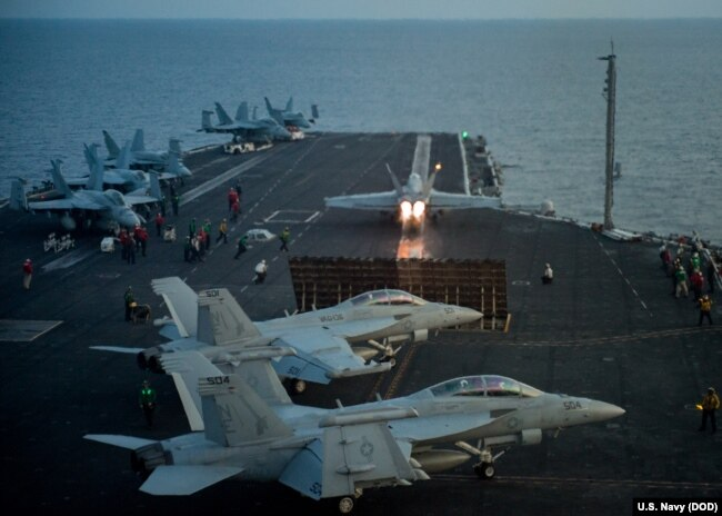 "An F/A-18E Super Hornet from the Strike Fighter Squadron (VFA) 137 ""Kestrels"" takes off from the aircraft carrier USS Carl Vinson (CVN 70) flight deck in South China Sea, April 12, 2017."