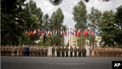 Romanian military personnel stand in formation during a speech by NATO Secretary General Jens Stoltenberg at the site of the first NATO Force Integration Unit in Bucharest, Romania, July 2, 2015.