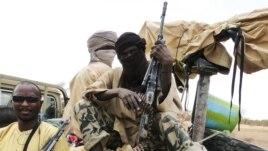 Wanamgambo wa kundi la  Ansar Dine wakiwa kwenye gari huko Gao kaskazini Mashariki mwa  Mali.