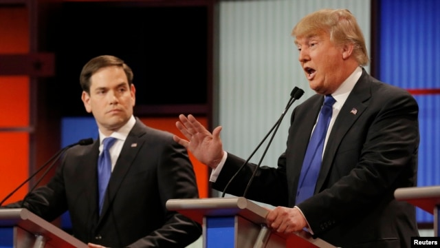 Republican U.S. presidential candidate Marco Rubio listens as rival candidate Donald Trump speaks at the U.S. Republican presidential candidates debate in Detroit, Michigan, March 3, 2016.