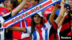 A fan displays her allegiance before a 2014 World Cup game against Greece. (FILE PHOTO)
