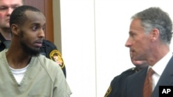 FILE - Abdirahman Sheik Mohamud, left, speaks with his attorney, Sam Shamansky, during a hearing to set bond on charges of money laundering and providing support for terrorism in Columbus, Ohio, Feb. 25, 2015.