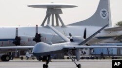 FILE - A Predator B unmanned aircraft taxis at the Naval Air Station in Corpus Christi, Texas, Nov. 8, 2011.