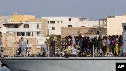 Rescued migrants, some of the more than 3,000 rescued Saturday by Italy and France in the Mediterranean Sea near Libya, arrive in the harbor of Lampedusa, southern Italy, May 2, 2015.
