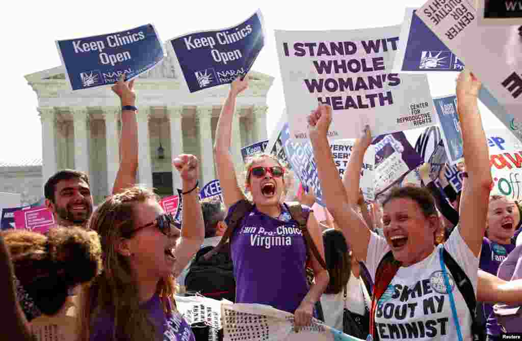 Demonstrators celebrate outside the U.S. Supreme Court after the court struck down a Texas law imposing strict regulations on abortion doctors and facilities that its critics contended were specifically designed to shut down clinics, in Washington.
