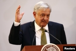 FILE - Mexico's President Andres Manuel Lopez Obrador gestures during a meeting in Mexico City, Mexico, Dec. 17, 2018.