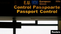 FILE - An EU sign is seen in the passport control area at Bucharest's Henri Coanda International Airport, Jan. 1, 2007. Many Turks are hoping a just concluded refugee deal with Brussels will eventually offer them visa-free travel in the EU.