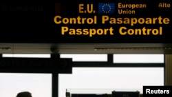 FILE - A man is seen walking in the passport control area at Bucharest's Henri Coanda International Airport.