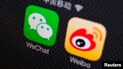 FILE- A picture illustration shows icons of WeChat and Weibo app in Beijing, Dec. 5, 2013.