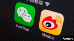 FILE - A picture illustration shows icons of WeChat and Weibo app in Beijing.